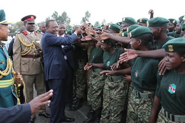 President Uhuru Kenyatta greets National Youth Service recruits after a parade at the NYS college in Gilgil on September 10, 2014.