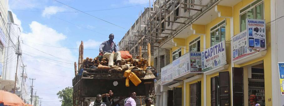 A truck drives through Bakara market in Mogadishu October 5, 2013. Street lamps now brighten some of Mogadishu's battle-scarred roads and couples hold hands at the seaside next to bombed-out beachfront buildings, a scene that would have been unthinkable w