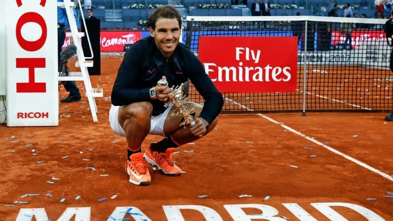 Spanish tennis player Rafael Nadal poses with his trophy as he celebrates his victory over Austrian tennis player Dominic Thiem at the end of the Madrid Masters