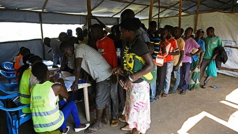 Newly arrived refugees from South Sudan queue to be registered at Kuluba Reception Centre, north of the Ugandan capital Kampala
