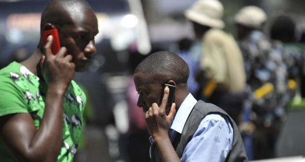 An individual on phone, photo courtesy (Simon Maina/AFP)