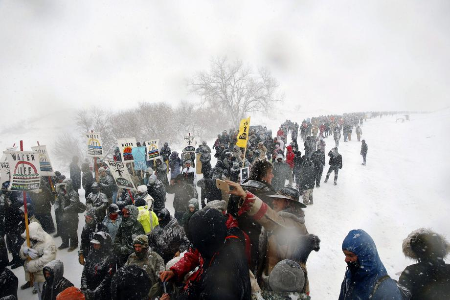 Veterans march with activists near Backwater Bridge just outside of the Oceti Sakowin camp during a