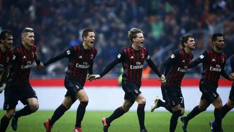 AC Milan's players celebrate after winning the Italian Serie A match against Crotone on December 4, 2016 at the 'San Siro Stadium' in Milan
