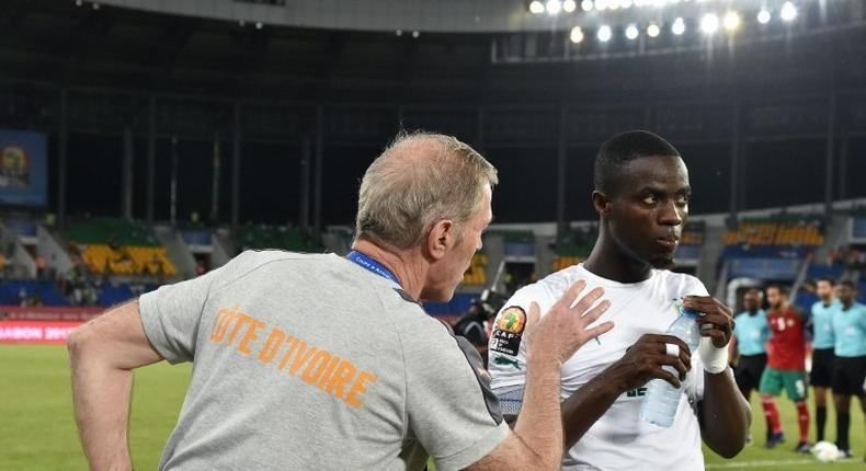 Ivory Coast's coach Michel Dussuyer (L) speaks to defender Eric Bailly ahead of the team's Africa Cup of Nations match against Morocco on January 24, 2017