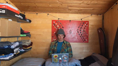 I spent 9 months in a tiny home on my employer's property with just enough room for my bed and snowboards - here's what it was like