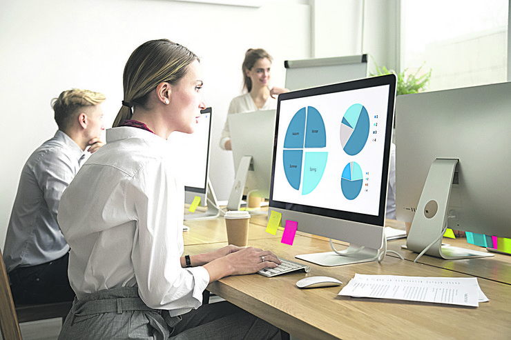 stock-photo-focused-young-woman-works-with-statistics-charts-using-computer-in-office-serious-female-sales-1032426154