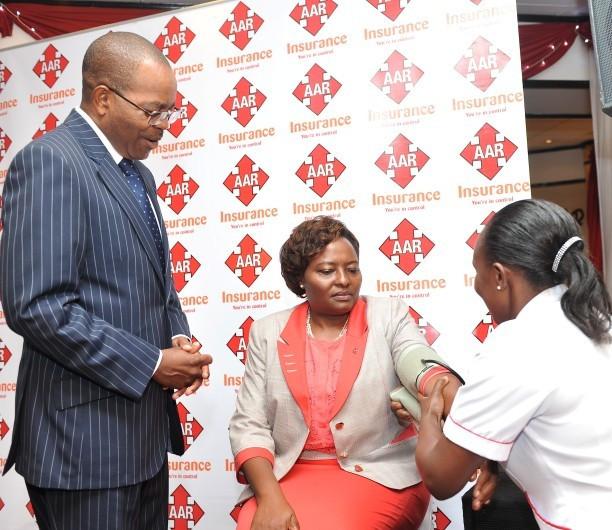 AAR Kenya managing director Caroline Munene being examined by a nurse during a past function. (smartinvestor)