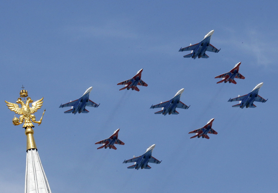 SU-27 and MIG-29 military jets fly in formation during the Victory Day parade above Red Square in Moscow