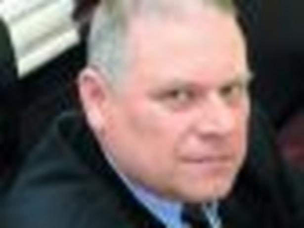 dr Janusz Fiszer, partner w firmie doradczej PwC, docent Uniwersytetu Warszawskiego
