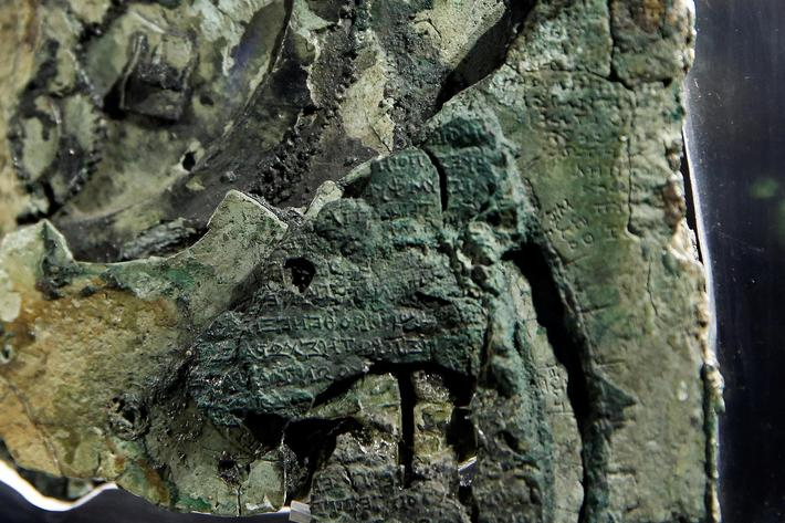 Detail of a fragment of the ancient Antikythera Mechanism displayed at the National Archaeological M