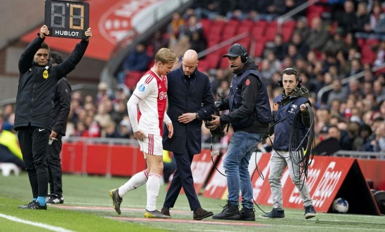 Ajax's Frenkie de Jong (C) is a doubt after going off injured during a Dutch league game at the weekend