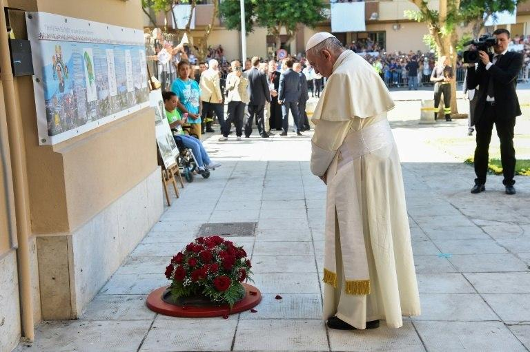 Pope Francis laid a wreath of flowers outside the modest Palermo home of Father Giuseppe Puglisi who was murdered here by the mob in 1993