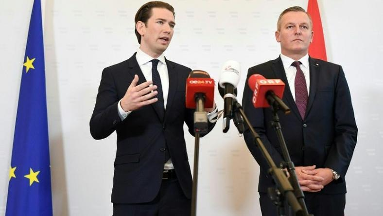 Austrian Chancellor Sebastian Kurz (L) told a press conference that the retired colonel is suspected of working with Russian intelligence from the 1990s until 2018