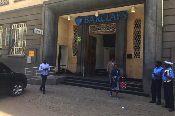 File image of police officers keeping guard outside Barclays Bank of Kenya Queensway Branch in Nairobi where Sh 2Billion in fake currency was recovered on March19, 2019.