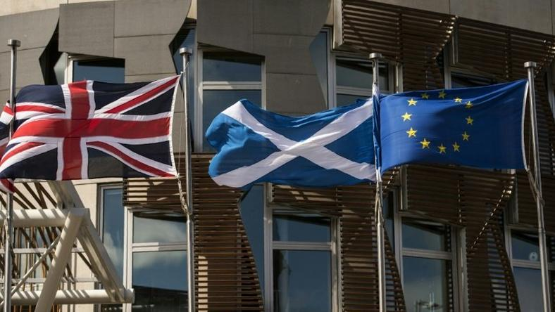The British, Scottish and EU flags in front of the Scottish Parliament in Edinburgh