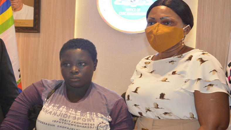 Amputee hawker, Mary Daniel, with the Special Adviser Office of Civic Engagement, Princess Adebowale Aderemi [LASG]