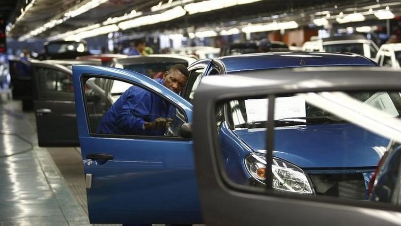 A worker inspects cars at Nissan's manufacturing plant in Rosslyn, outside Pretoria, in a file photo. REUTERS/Siphiwe Sibeko