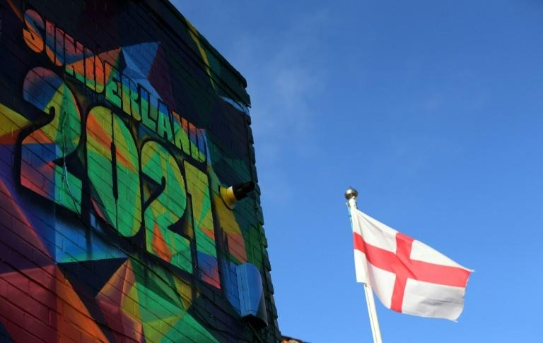 A St George's cross flag flies by a mural promoting Sunderland's bid to be 2021 UK City of Culture