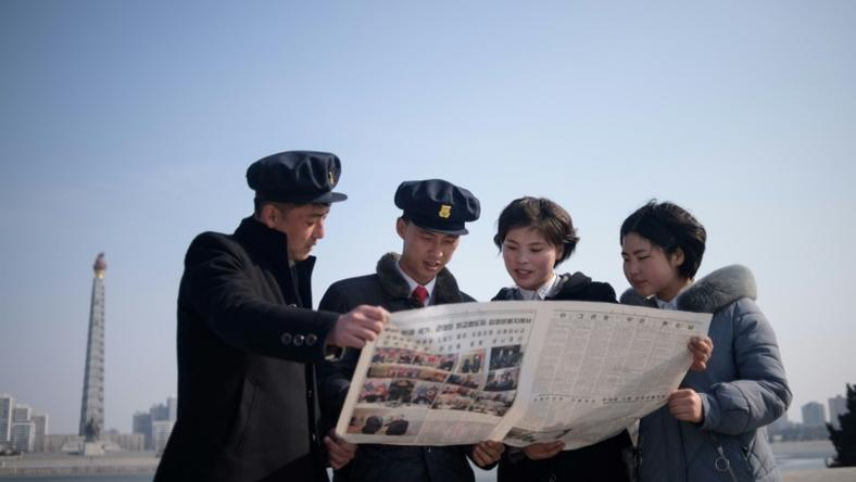 North Korean students read the newspaper coverage of Kim Jong Un's summit with US President Donald Trump