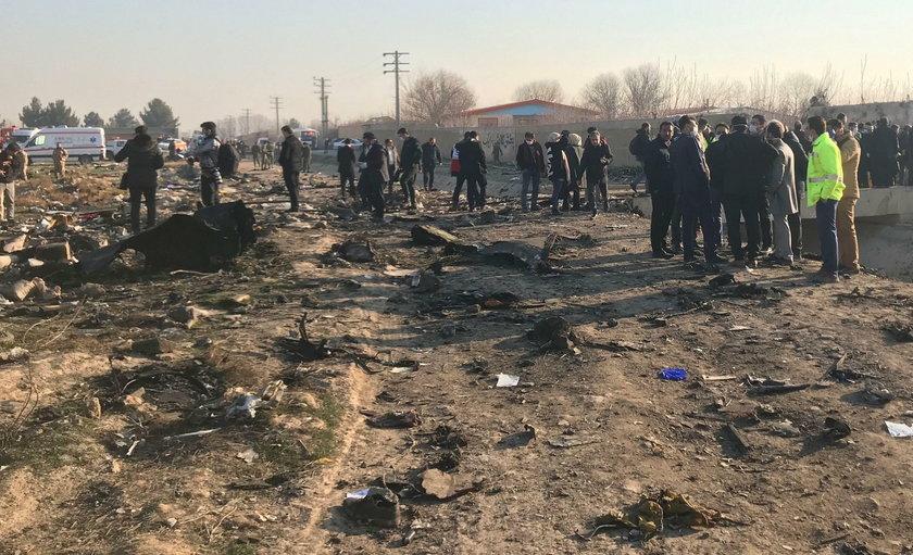 Emergency workers work near the wreckage of Ukraine International Airlines flight PS752, a Boeing 73