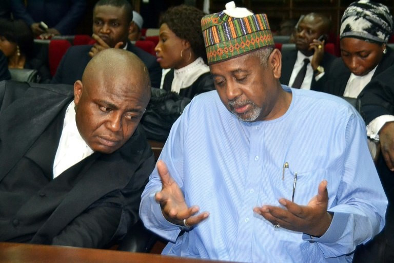 Former national security adviser of ex-president Goodluck Jonathan, Sambo Dasuki (right), speaks with his lawyer Ahmed Raji, during his trial at the federal high court in Abuja, on September 1, 2015 (The Nation)