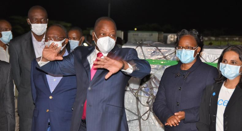 Health CS Mutahi Kagwe with other ministry officials when they received first consignment of Covid-19 vaccines at JKIA