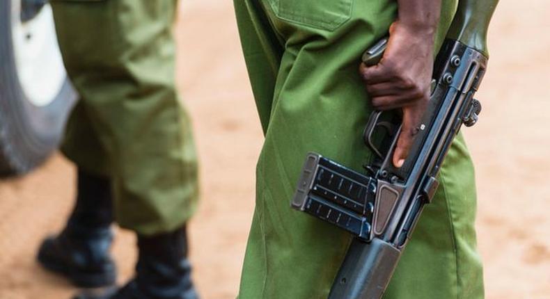 A Kenyan police officer holding a gun (Courtesy)