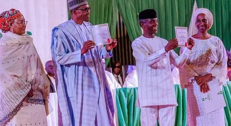 Muhammadu Buhari and Prof. Yemi Osinbajo displaying their certificates of return after winning February 2019 presidential election