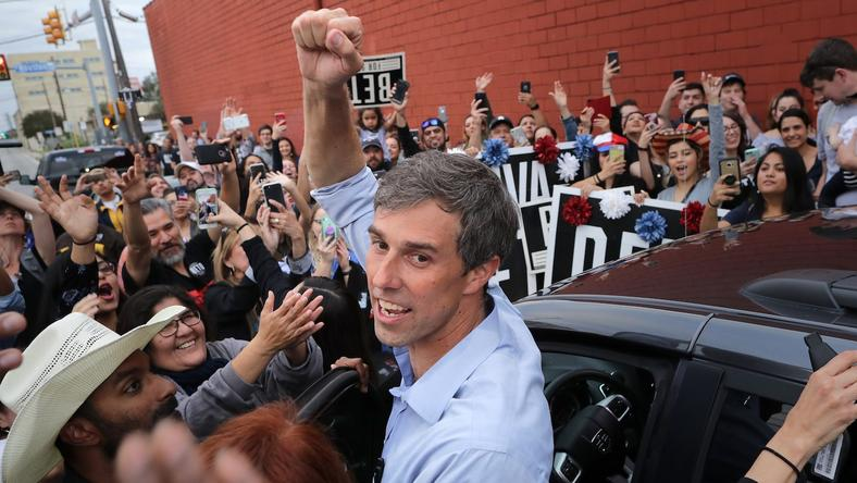 US Senate candidate Rep. Beto O'Rourke (D-TX) pumps his fist for a cheering crowd before departing a campaign rally at the Alamo City Music Hall in San Antonio, Texas.
