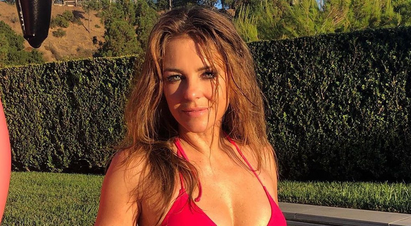 Elizabeth Hurley, 54, Just Showed Off Her Abs While Rocking A Hot Pink Bikini On Instagram
