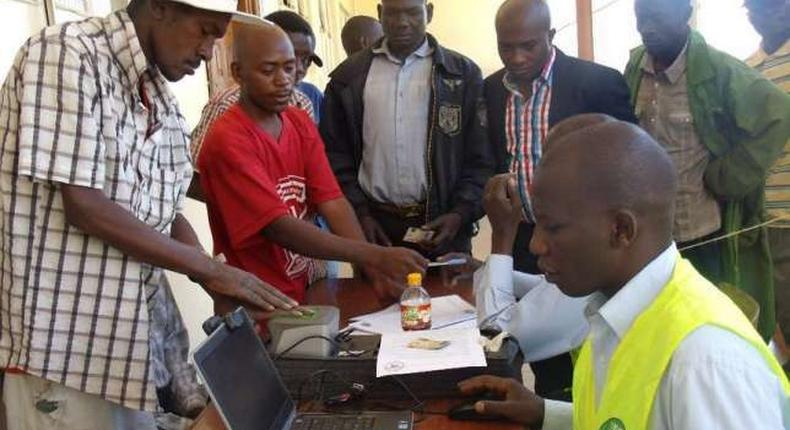 An Independent Electoral and Boundaries Commission official registers voters in Eldoret town.