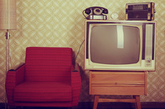 stock-photo-vintage-room-with-wallpaper-old-fashioned-armchair-retro-tv-phone-clocks-radio-player-and-132384281