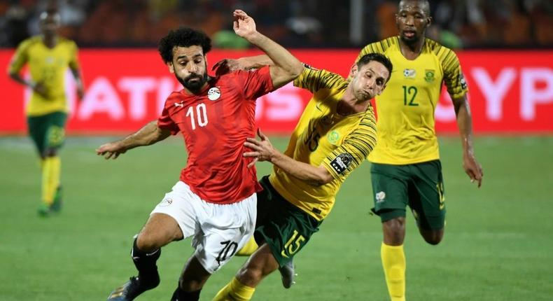 Prolific scorer Mohamed Salah (L) playing for hosts Egypt against South Africa in the 2019 Africa Cup of Nations Creator: Khaled DESOUKI