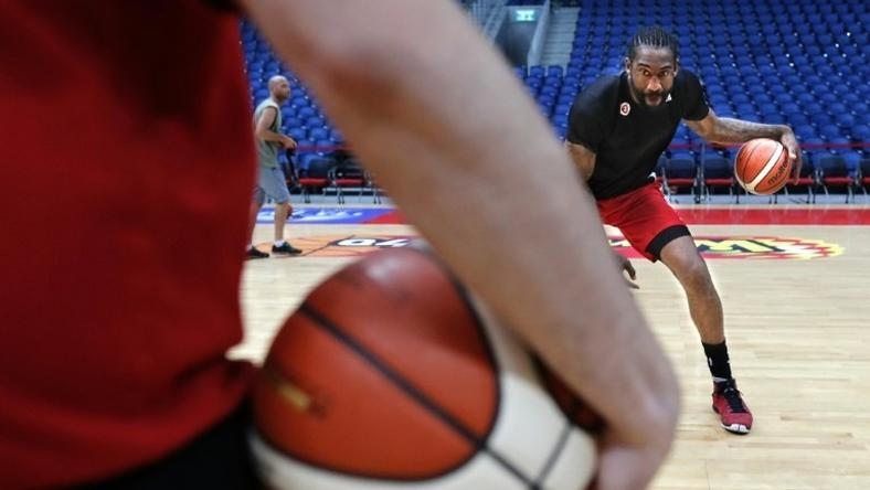 Former NBA All-Star Amar'e Stoudemire practises some dribbling during a basketball training session with his new club Hapoel Jerusalem on October 7, 2016