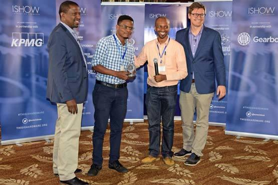 Sign-io's Founder Roy Allela (center) accepts his trophy from LR Kamau Gachigi (left