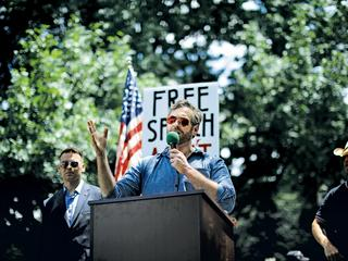Mike Cernovich speaks during a rally about free speech outside of the White House in Washington