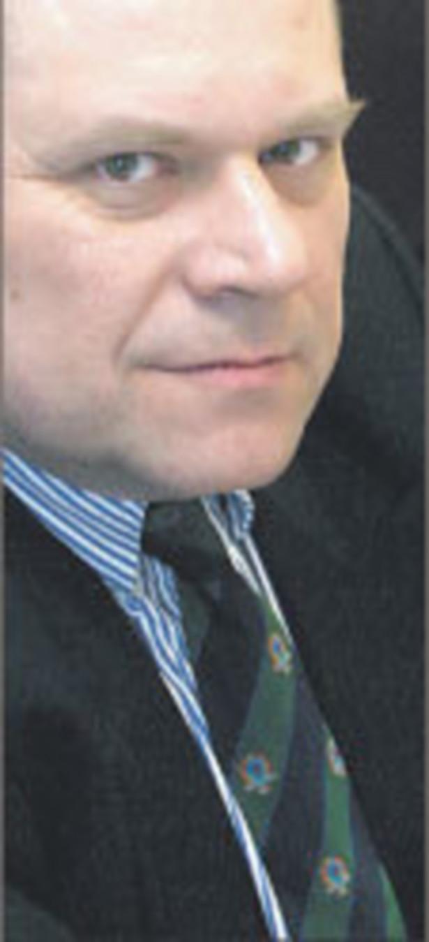 dr Janusz Fiszer, partner w Kancelarii Prawnej White & Case i docent UW