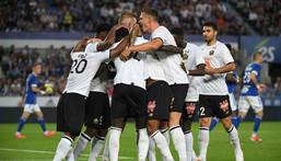 Lille players celebrate after Jonathan David put them ahead against Strasbourg Creator: PATRICK HERTZOG
