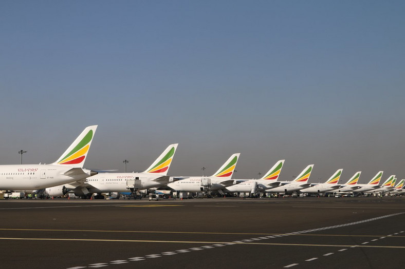 Ethiopian Airlines parked at an airport.
