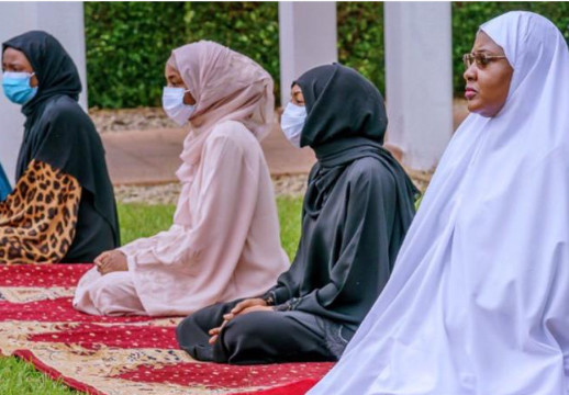 Aisha Buhari joined the president to observe the eid prayers at the Presidential Villa, Abuja. (Punch)