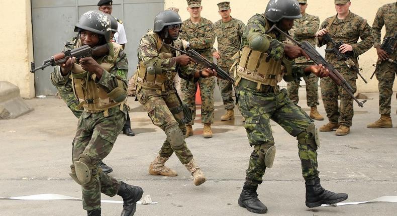 Angolan troops practice room-clearing maneuvers in Luanda as U.S. Marines observe. U.S. Marine Corps photo