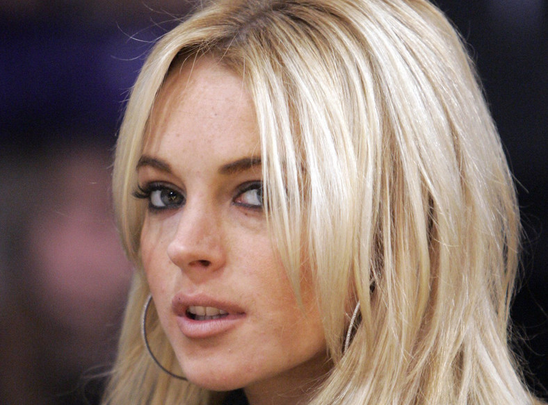 ** FILE ** Actress Lindsay Lohan is seen at the Los Angeles Lakers game against the Orlando Magic in their NBA basketball game, in this Dec. 2, 2007, file photo in Los Angeles. Court papers filed Tuesday, Dec. 4, 2007, allege the busboy who sued Lindsay Lohan has proof the actress had been drinking before she collided with his van in October 2005. Raymundo Ortega contends that Lohan drove her Mercedes-Benz into a van he was driving after she drank alcohol and later tried to escape paparazzi. He is seeking $200,000 in damages.  (AP Photo/Mark J. Terrill, file)