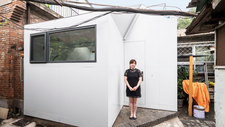 Mrs. Fan and her Plug-in House in Changchun Jie, China.