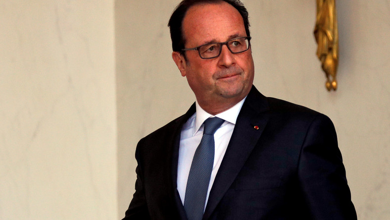 French President Francois Hollande walks to his office at the Elysee Palace in Paris, France, following the weekly cabinet meeting