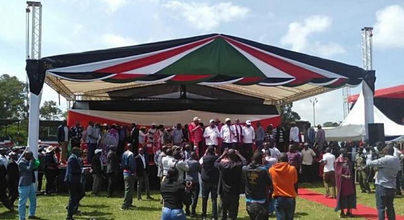Raila Odinga flanked by senior government officials and politicians at the Narok BBI rally