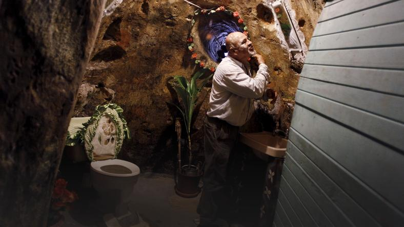 Manuel Barrantes shaves in a bathroom of his house he built underground in San Isidro de Perez Zeledon, Costa Rica