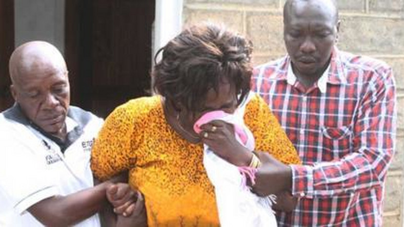 Family members overcome by grief during the burial of Collins Kipyegon Kalya