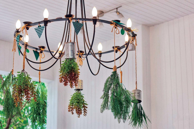 stock-photo-the-minimalism-chandelier-with-hanging-plant-around-wrap-with-flag-rope-hang-on-the-white-ceiling-1441036304