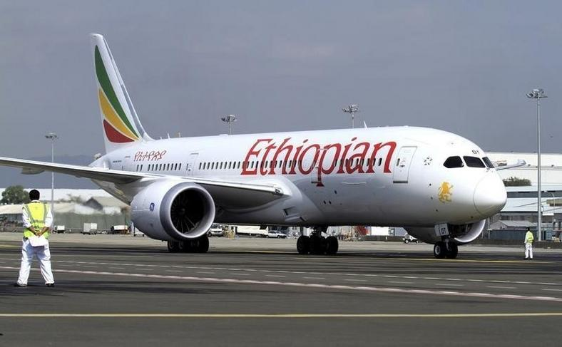 A member of the ground crew directs an Ethiopian Airlines plane at the Bole International Airport in Ethiopia's capital Addis Ababa, August 21, 2015.   REUTERS/Tiksa Negeri