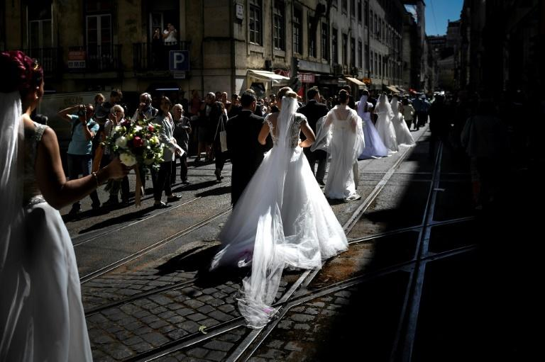 The multiple wedding ceremony is followed by a giant parade